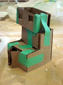 Make house out of cardboard and sticky tape